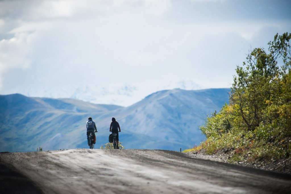 Two cyclists on gravel road