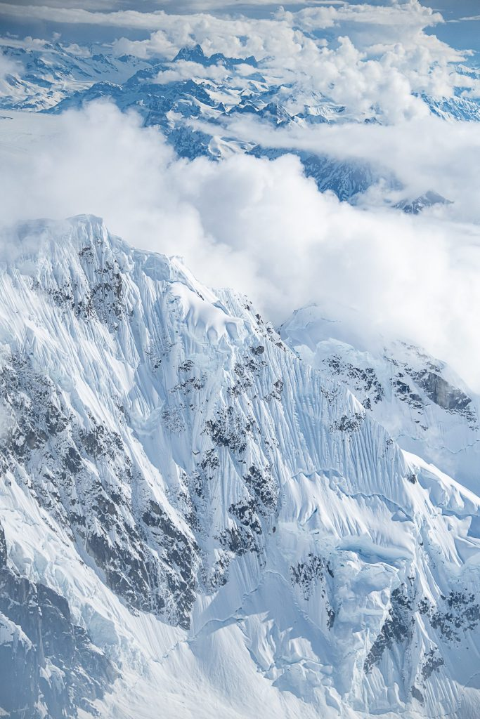 Snow-covered mountains in the Alaska range from an aerial perspective