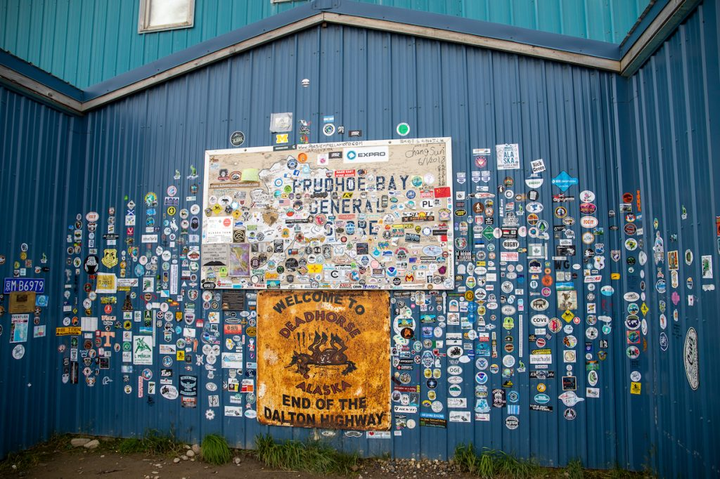 Stickers cover blue metal walls at the Prudhoe Bay General Store in Deadhorse, Alaska