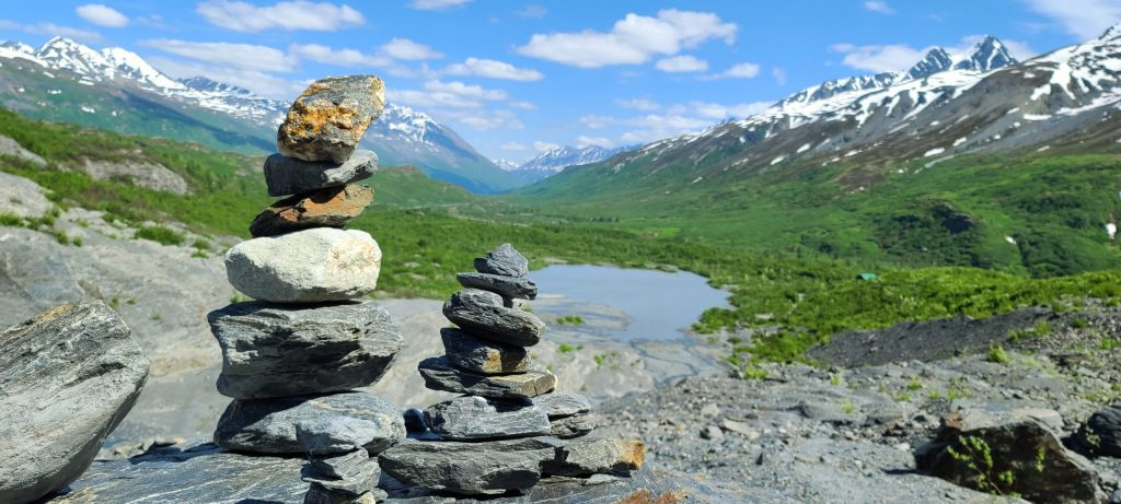 Rock Cairns at the head of a green valley