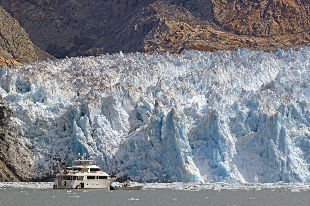 Sawyer Glacier with a yacht near the face