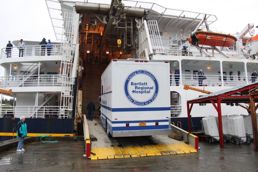 Truck belonging to Bartlett Regional Hospital boards the Alaska state ferry